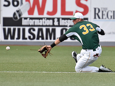 (Brad Davis/The Register-Herald) West Virginia shortstop Paul Trick slides to play a sharp ground ball off the bat of Lafayette's Chad Schultz that would get by him for a base hit during the Miners' loss to the Aviators Sunday evening at Linda K. Epling Stadium.