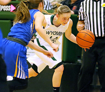 (Brad Davis/The Register-Herald) Wyoming East's Jasmine Blankenship hustles the ball up the court during the Lady Warriors' win over the Irish Friday night in New Richmond.