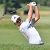 (Brad Davis/The Register-Herald) Xander Schauffele shoots from the fairway on 12 during the Military Tribute at The Greenbrier Sunday afternoon in White Sulphur Springs.