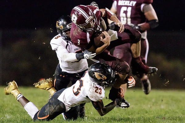 Woodrow Wilson Flying Eagle, Peyton Shehan, goes flying for a few more yards, but is tripped up by South Charleston's Tyson Rohmiller. Chad Foreman for the Register-Herald.