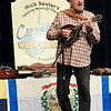 "Mike Souter performs his ""Celebrate West Virginia"" one-man show for West Virginia Day at Tamarack Thursday. Souter is a multi-instrumentalist who accompanies himself with varies instruments and tells tales that celebrate the people, history and culture of West Virginia. (Jenny Harnish/The Register-Herald)"