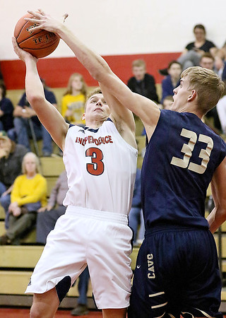 (Brad Davis/The Register-Herald) Independence's Ethan Testerman has his layup attempt blocked by Greenbrier West defender Riley O'Dell Friday night in Coal City.