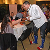 (Brad Davis/The Register-Herald) Noah Shrewsbury had already managed to break both heels by the time participants hit the floor to mingle with fans during the annual Hunks in Heels fundraising event for the Women's Resource Center Friday night at the Beckley Moose Lodge.