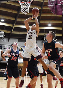 Woodrow Wilson's Eddie Christian (30) goes up for a shot over Parkersburg South defenders during the first quarter of their basketball game in Beckley Tuesday. (Chris Jackson/The Register-Herald)