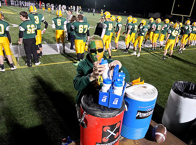 Brad Davis/The Register-Herald Decked out in Spartan colors, Greenbrier East equipment manager Zach Wright does the underrated yet critical job of keeping the team hydrated during their game against Parkersburg South Friday night in Fairlea.