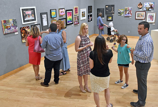 (Brad Davis/The Register-Herald) Artists, entusiasts friends and family members mingle during the opening reception for Good Enough to Eat: Please Don't Eat the Art, the newest juried art exhibition at Tamarack that will be on display until September 23.