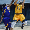 Carlow University's Malcolm Randall, left, defends as WVU Tech University's Tamon Scruggs drives for the score during Friday evening action in Beckley. F. Brian Ferguson