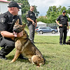 "(Brad Davis/The Register-Herald) Sheriff Scott Van Meter, middle, looks on as Lt. Jason Redden, left, handles Cody while Sgt. Bobby Stump handles Clutch, two of three new K-9 members to join the force at the Raleigh County Sheriff's Office, during a ""meet and greet"" with local media Thursday afternoon. Both dogs are serving as narcotics, apprehension and tracking dogs while a third dog, a 9-week-old bloodhound puppy named Trigger, will be ready for active duty in a few months."