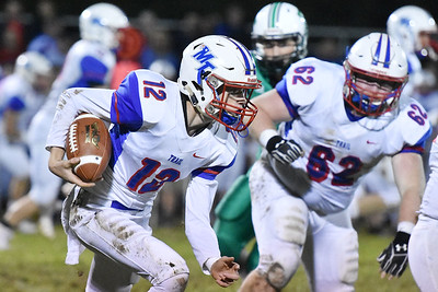 Midland Trail's Austin Isaacs (12) carries out of the pocket during their high school football game against Fayetteville Friday in Fayetteville. (Chris Jackson/The Register-Herald)