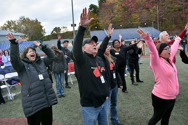 (Brad Davis/The Register-Herald) Attendees enjoy a performance from musician and pastor Judy Jacobs, one of many activities taking place during the first I Am Ingathering all-day event Saturday afternoon at Linda K. Epling Stadium.