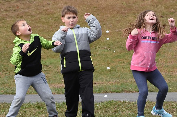 Hunter, Lilly, Owen Moomaw and Laila Cuthbert, second graders at Sophia Soak Creek Elementary School react after watching their teacher, Andrea Treadway launch a rocket that they made from a pop bottle, mixed with vinegar and baking soda.. <br /> (Rick Barbero/The Register-Herald)