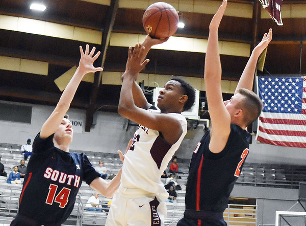 Woodrow Wilson's Tyriek Walton (14) gets a shot off over Parkersburg South's (14) and (22) during the second quarter of their basketball game in Beckley Tuesday. (Chris Jackson/The Register-Herald)