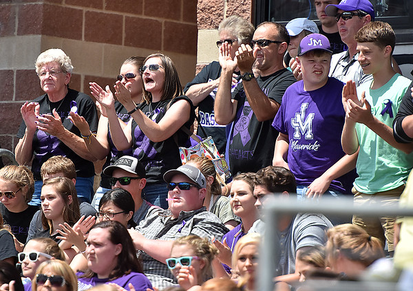 (Brad Davis/The Register-Herald) James Monroe fans and family applaud their Mavericks on a strong season shortly after losing a 4-3 heartbreaker against the Bridgeport Indians Friday afternoon at Appalachian Power Park in Charleston.
