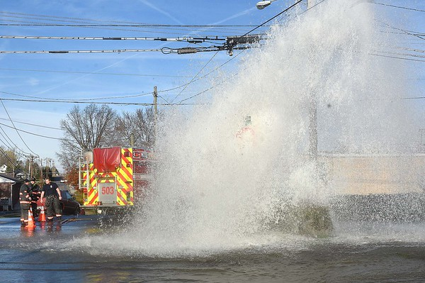 Dollar General truck ran over a fire hydrant and busted the line on the corner of South Fayette and F Street in Beckley Friday afternoon.<br /> (Rick Barbero/The Register-Herald)