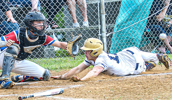 F. Brian Ferguson/Register-Herald  Midland Trail catcher Cody Harrell waits for the throw home as Greenbrier West's Chase McClung slides in ahead of the throw for the score during Monday evening action at Midland Trail.