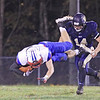 Midland Trails Colton Yoder is brought down by Greenbrier West's John Parks during Friday night's game at Greenbrier West High School. (Jenny Harnish/The Register-Herald)