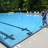 Luke Feldhake, lifeguard at Historic Black Knight pool, skims debris of the water getting it ready to open this Saturday, May 29. Pool hours will be, 11 am to 6 p.m. Tuesday through Saturday, 1 p.m. to 6 p.m. on Sunday and closed Monday's. The New River Park pool will not open due to the lack of lifeguards.<br /> (Rick Barbero/The Register-Herald)