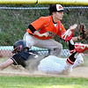 (Brad Davis/The Register-Herald) Greater Beckley Christian baserunner David Wilson dives safe into third as the throw gets to Summers County 3rd baseman Nathan Wykle Friday evening at Park Middle School.