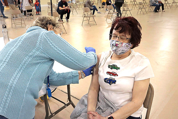 Pamela Scott receives her second coronavirus vaccine at the State Fairgrounds Thursday. Thursday was the last day of the weekly vaccine clinics put on by the Greenbrier County Health Department. Jenny Harnish for the Register-Herald.