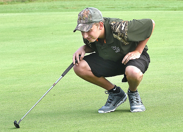 Brett Laxton, looks over his putt on the par 4, 5th hole at Grandview Country Club during the Class AA Regional High School Golf Tournament.  (Rick Barbero/The Register-Herald)