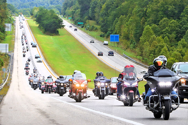 Riders with NASCAR's Kyle Petty Charity Ride arrive on US-19 near the New River Gorge Thursday.   The three-day Charity Ride Revival is reuniting riders for scenic riding after more than two years apart due to the COVID-19 pandemic. The organization raises funds for Victory Junction and other charities that support chronically ill children.  Jenny Harnish/The Register-Herald