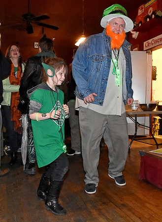(Brad Davis/The Register-Herald) Lewisburg residents Maya Frank, 7, and her dad Rob dance an Irish jig during a performance by musicians Patrick O'Flaherty & Brendan Sheridan inside Irish Pub following Lewisburg's shortest St. Patrick's Day Parade Friday evening.