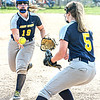 F. Brian Ferguson/Register-Herald  Shady Spring First baseman Wood tosses the ball to second baseman Presley for the out against James Monroe during Tuesday action in Shady Spring.