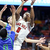 Oak Hill's Andrew Work (0) puts a shot up over Robert C. Byrd's  Khori Miles (0) <br /> during their West Virginia State Championship Class AA Quarter Finals in Charleston on Thursday. (Chris Jackson/The Register-Herald)