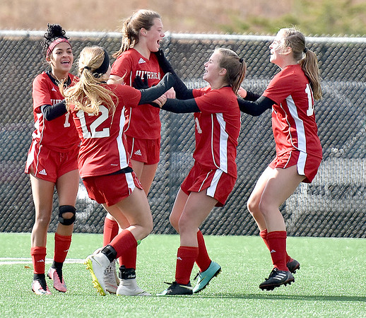 (Brad Davis/The Register-Herald) Hurricane's Bailey Fisher (3rd from left) is mobbed by teammates after scoring the Redskins' first goal of the game during the first half of the Class AAA Girls State Championship match against Wheeling Park Saturday morning at the YMCA Paul Cline Memorial Sports Complex.