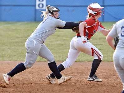 (Brad Davis/The Register-Herald) Shady Spring 3rd baseman Bradlea Hayhurst chases down and tags Independence baserunner Caroline Parrish after catching her in a rundown Thursday evening in Shady Spring.