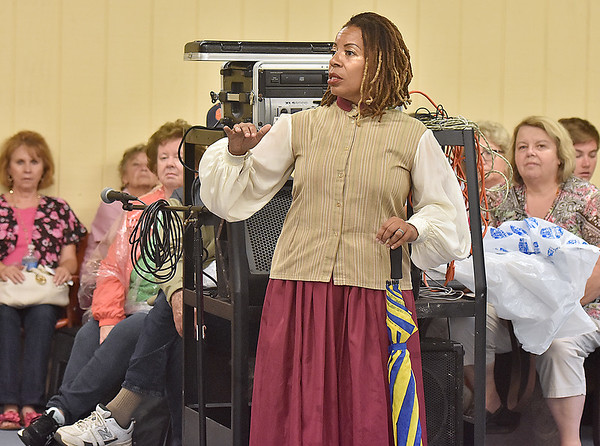 (Brad Davis/The Register-Herald) Theatre West Virginia actress Rhayne Thomas speaks to audience members about her battle with breast cancer before thanking everyone for their support during a rain delay prior to the year's final performance of Hatfields & McCoys Sunday evening at Grandview's Cliffside Amphitheatre. Thomas has now been cancer free for 7 years.