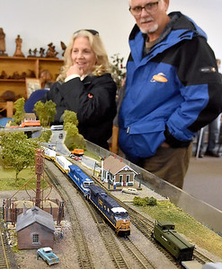 (Brad Davis/The Register-Herald) Hinton residents Linda and Randy Hampton marvel at the detail and craftsmanship of a miniature railroad town and its trains in the upsatirs area of the town's railroad museum during Hinton Railroad Days Sunday afternoon. Both of their grandparents have a history working on the railroads. Linda had a grandfather who was a C&O engineer while the other worked on the railroads, while Randy had a grandfather who worked on the railroads in Tennessee.