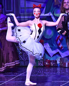(Brad Davis/The Register-Herald) The Mechanical Doll, played by Aleksus Mays, dances after being wound up with a key by Uncle Drosselmeyer during a scene from Beckley Dance Theatre and Beckley Performing Arts' presentation of The Nutcracker Sunday afternoon inside the Woodrow Wilson High School Auditorium.
