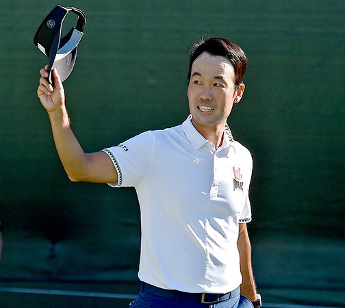 (Brad Davis/The Register-Herald) Kevin Na waves to fans as he comes out to accept the trophy during the Military Tribute at The Greenbrier Sunday afternoon in White Sulphur Springs.