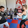 Hope McNeely, owner of A-Train Boxing & Fitness Studio in Mullens, right, working with Matthew Campbell.<br /> (Rick Barbero/The Register-Herald)