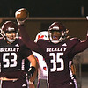 Matthew Moore, of Woodrow Wilson, right, celebrates after scoring a touchdown against  Morgantown in the first half during game held at Woodrow Wilson High School.<br /> (Rick Barbero/The Register-Herald)