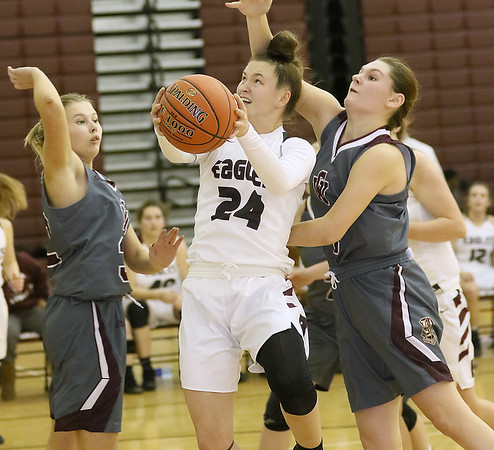 (Brad Davis/The Register-Herald) Woodrow Wilson's Liz Cadle drives to the basket as George Washington's Kaya Thompson, left, and Lauren Harmison defend Thursday night in Beckley.