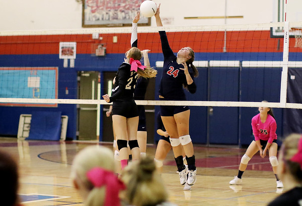 Chris Jackson/The Register-Herald Independence's Madison Testement (24) spikes a volley over Liberty's Taylor Daniel (23) during their match in Coal City.