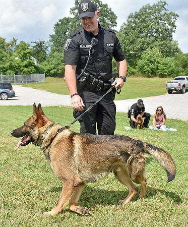 """(Brad Davis/The Register-Herald) Lt. Jason Redden handles Cody, one of three new K-9 members to join the force at the Raleigh County Sheriff's Office, during a """"meet and greet"""" with local media Thursday afternoon. Cody is serving as a narcotics, apprehension and tracking dog."""