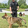 "(Brad Davis/The Register-Herald) Lt. Jason Redden handles Cody, one of three new K-9 members to join the force at the Raleigh County Sheriff's Office, during a ""meet and greet"" with local media Thursday afternoon. Cody is serving as a narcotics, apprehension and tracking dog."