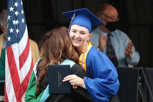 Ariana Brooke Mooney hugs a faculty member after receiving her diploma from Greenbrier West at the 2021 commencement ceremony in Fairlea Saturday. Jenny Harnish for the Register-Herald