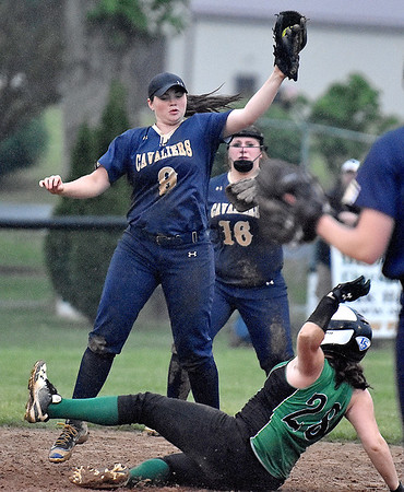 (Brad Davis/The Register-Herald) Fayetteville baserunner Lauren Spangler slides into 2nd base as Greenbrier West shortstop Brittany Bevins leaps to catch the high throw during the Pirates victory in a wild, 8 inning, 22-14 rain-soaked thriller against Greenbrier West Wednesday night at Huse Park in Fayetteville.