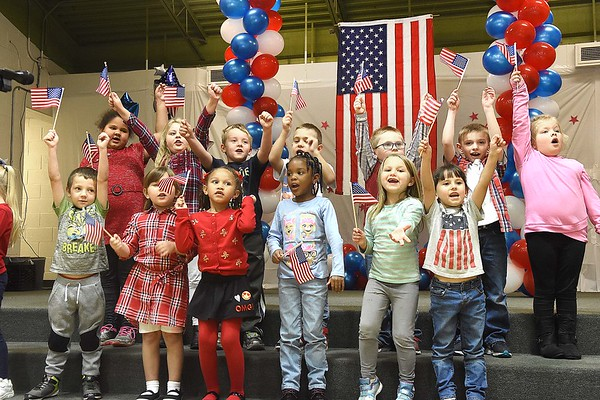 """Kindergarten class at Lester Elementary School waved flags and sang """"When the Flag Goes By"""" during a Vereran's Day program held at Lester Elementary School Wednesday afternoon.<br /> (Rick Barbero/The Register-Herald"""