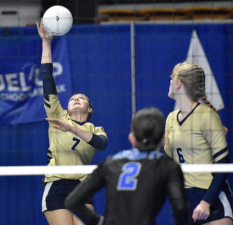(Brad Davis/The Register-Herald) Greenbrier West's Kenley Posten sends the ball back over against Tyler Consolidated during State Volleyball Tournament action Friday morning at the Charleston Civic Center.