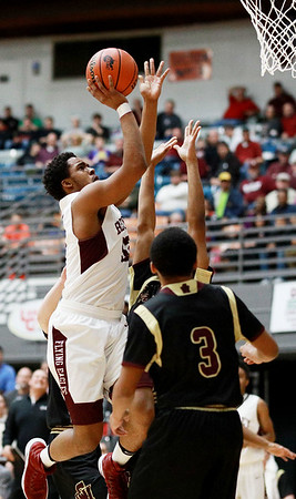 Woodrow's Breland Walton tries to get a shot off over two past George Washington players during their regional final Tuesday in Beckley. (Chris Jackson/The Register-Herald)