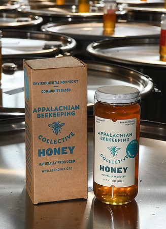 12 oz jar of honey produced by Appalachian Headwaters at Camp Waldo in Hinton<br /> (Rick Barbero/The Register-Herald)