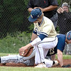 J.P.  Girod of Nicolas Co sliding back to first base when trying not to be picked off , Adam Richmond of Shady Spring with the tag, Thursday night during Sectionals at Shady Spring High School.<br /> TINA LANEY for Register-Herald