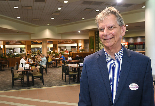 Brandon McCarter Food and Beverage Director for Tamarack, stand in the food court.<br /> (Rick Barbero/The Register-Herald)