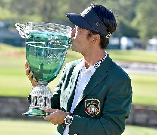 (Brad Davis/The Register-Herald) Kevin Na kisses the trophy after winning the Military Tribute at The Greenbrier Sunday afternoon in White Sulphur Springs.