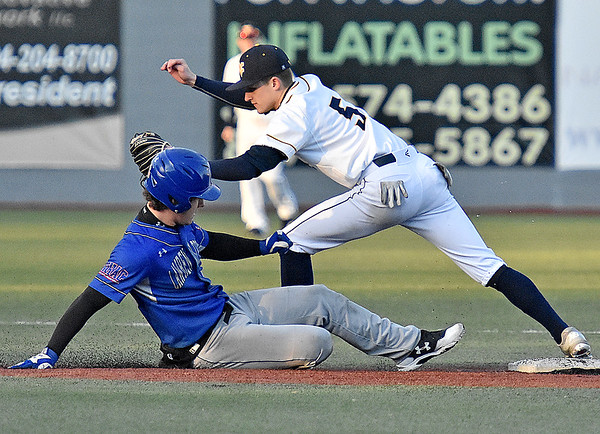 (Brad Davis/The Register-Herald) WVU Tech infielder Luke Cassidy doubles off Lawrence Tech baserunner Tyler Childs after a hit-and-run attempt off the bat of Harry Storch resulted in a line-out to left field Sunday afternoon at Linda K. Epling Stadium.